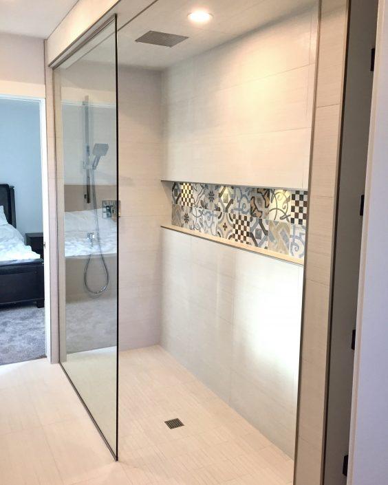 walk in shower tiled with custom niche