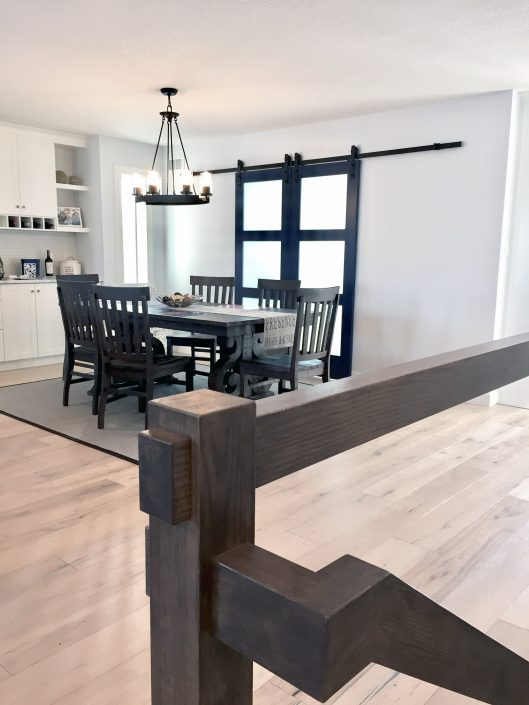 home renovations with barn doors and custom cabinets
