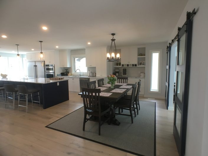 kitchen renovations with navy blue island and white cabinets