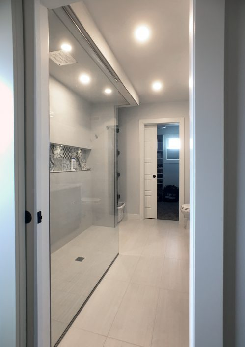 ensuite renovations with white tiled shower and custom niche