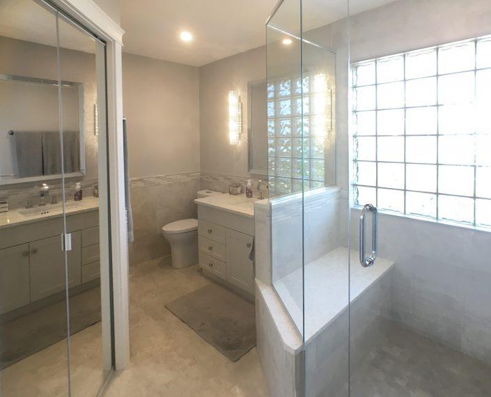 bathroom renovations white vanity and custom tiled shower