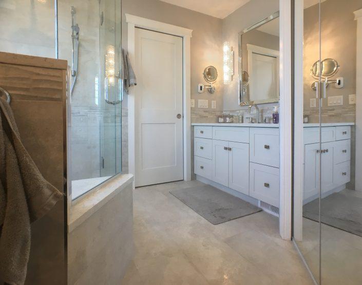 bathroom renovations light tile white cabinets