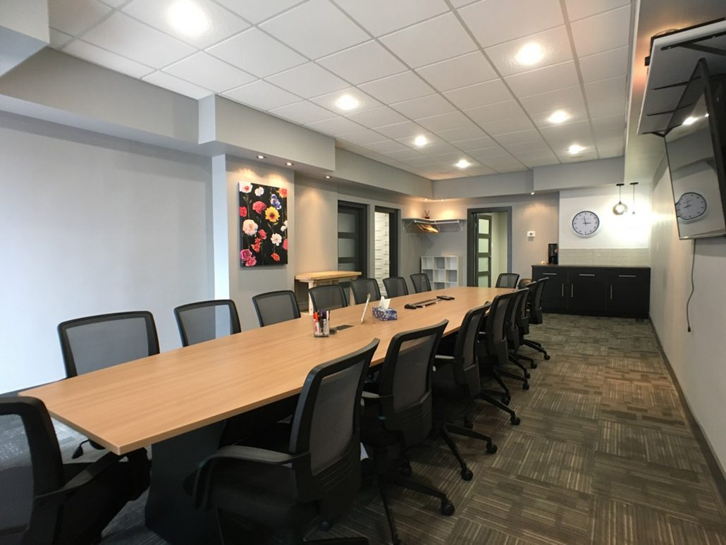 meeting room grey walls and wood table
