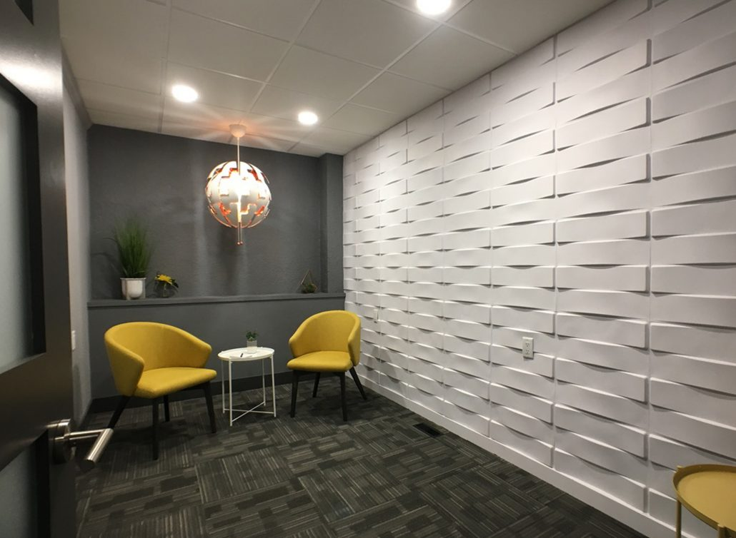 meeting room interesting 3D wall and yellow chairs