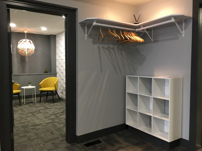 commercial renovations with grey interior and closet space