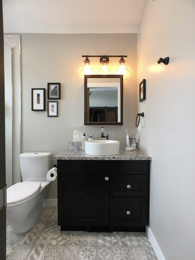 dark vanity grey walls ensuite