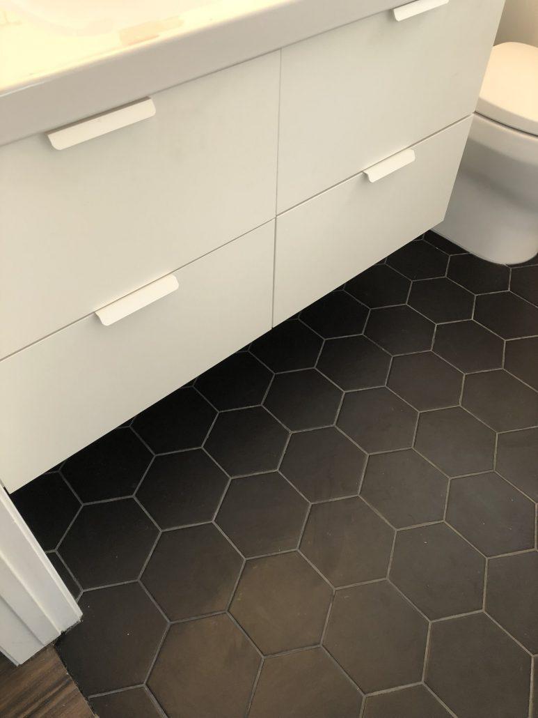 black and white bathroom vanity and floor