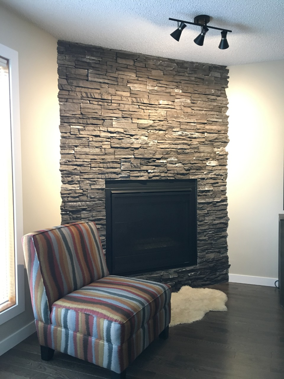 grey and white stacked stone fireplace