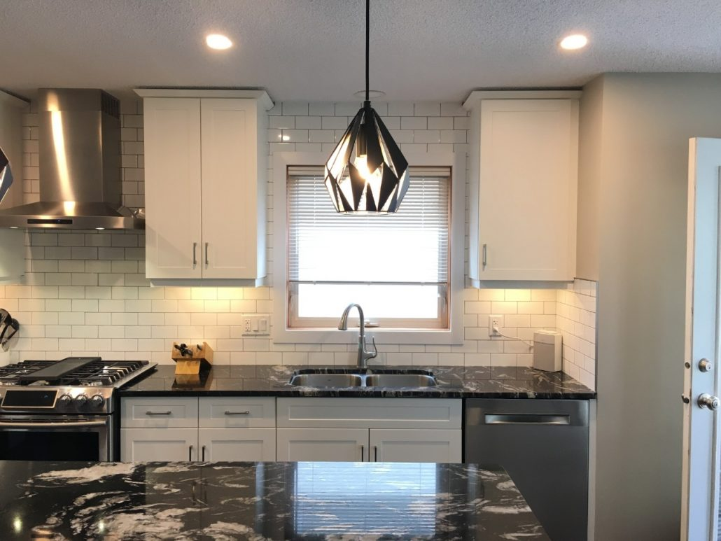 black geometric pendant light in kitchen
