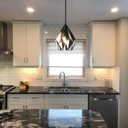 black geometric pendant light in kitchen