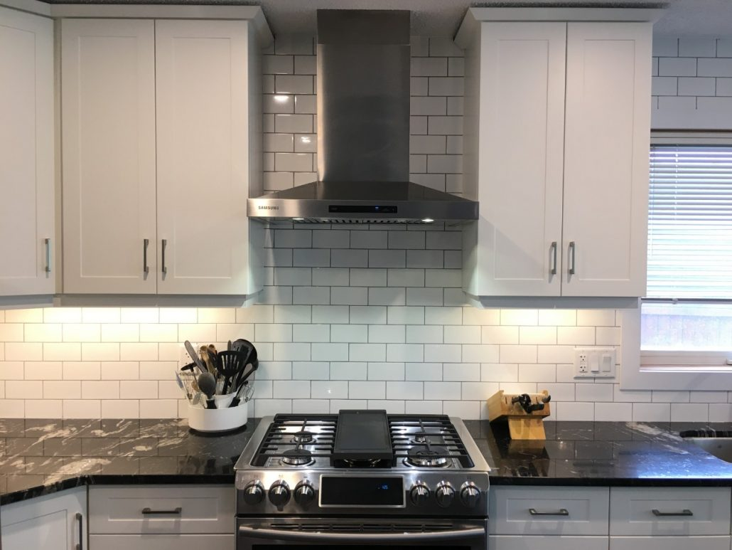 subway backsplash in white kitchen