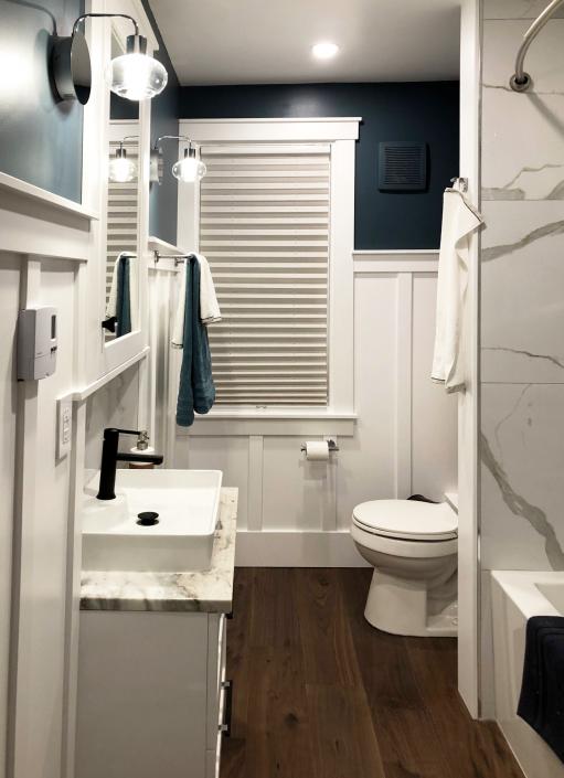 marble and walnut bathroom regina
