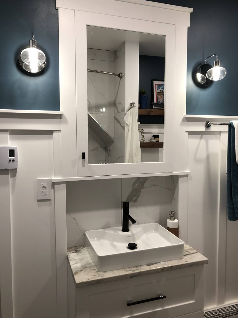 white vanity and medicine cabinet