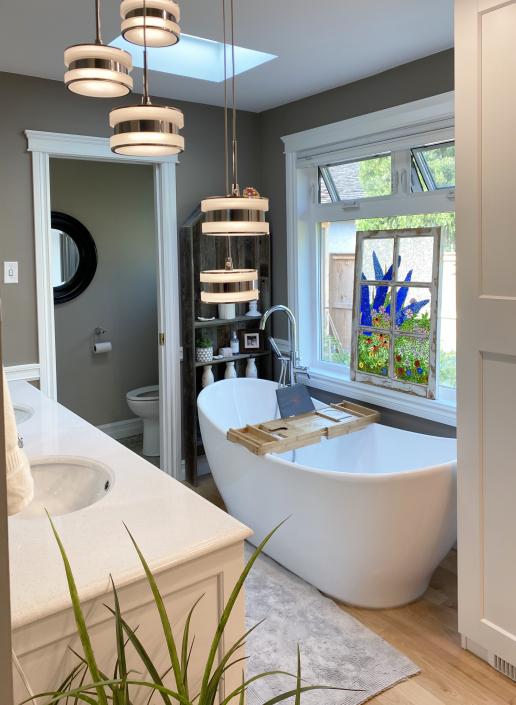 freestanding modern tub in renovated bathroom