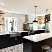 black kitchen with exposed brick