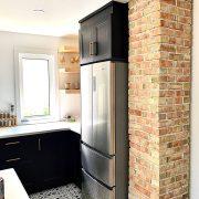 exposed brick black cabinets regina