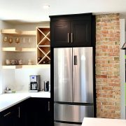 kitchen open shelving black cabinets exposed brick